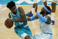 Charlotte Hornets forward Jalen McDaniels, left, fouls Los Angeles Lakers guard Wesley Matthews during the second half in an NBA basketball game on Tuesday, April 13, 2021, in Charlotte, N.C. (AP Photo/Chris Carlson)