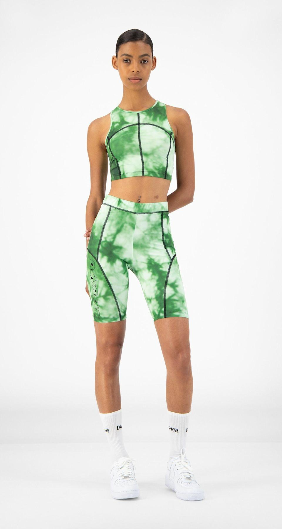"""<p><strong>Daily Paper</strong></p><p>dailypaperclothing.com</p><p><strong>74.00</strong></p><p><a href=""""https://www.dailypaperclothing.com/collections/women-all/products/green-tie-dye-resymetric-vest"""" rel=""""nofollow noopener"""" target=""""_blank"""" data-ylk=""""slk:Shop Now"""" class=""""link rapid-noclick-resp"""">Shop Now</a></p><p>The casual streetwear label maintains a steady stream of activewear that leverages psychedelic prints, neon piping and geometric silhouettes, altering convention in the aerobic exercise uniform. </p>"""