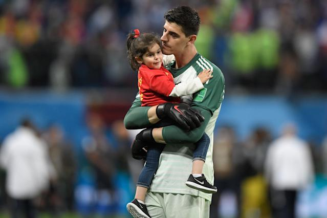 <p>Belgium's goalkeeper Thibaut Courtois carries his daughter, Adriana, as he greets the fans after their defeat in the Russia 2018 World Cup semi-final football match between France and Belgium at the Saint Petersburg Stadium in Saint Petersburg on July 10, 2018. – France reached the World Cup final on Tuesday after a second-half header from Samuel Umtiti gave them a 1-0 win against Belgium. (Photo by GABRIEL BOUYS / AFP) </p>