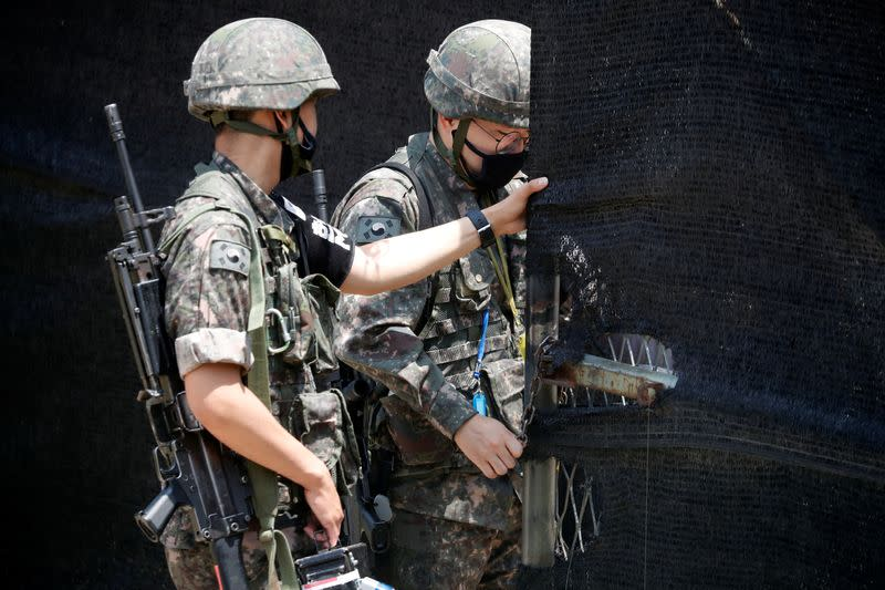 South Korean soldiers check an entrance of their guard post near the demilitarized zone separating the two Koreas in Paju