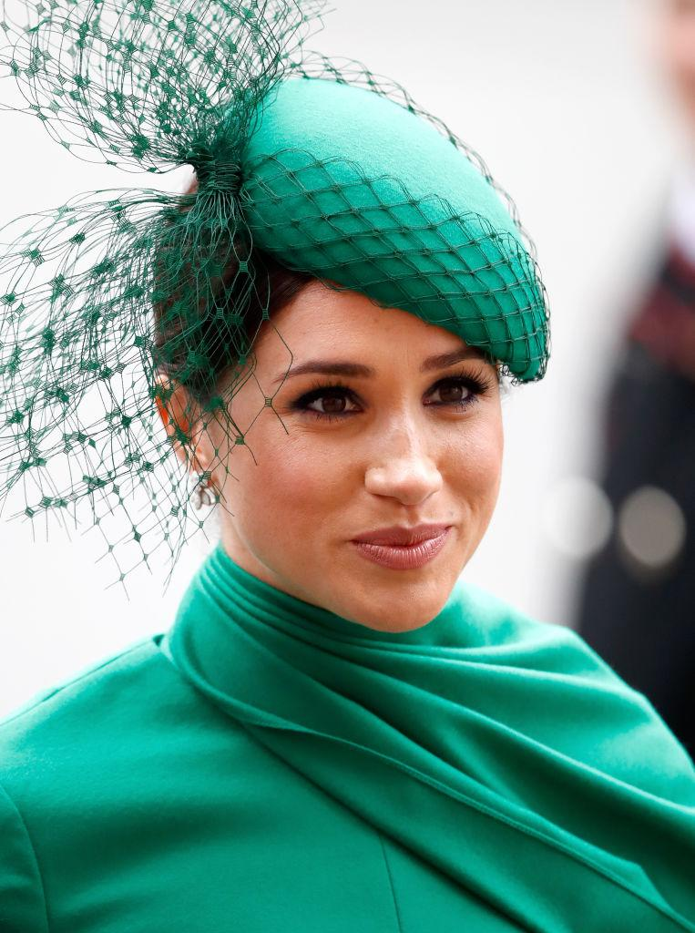 Meghan, Duchess of Sussex wears a green dress and matching hat at the Commonwealth Day Service 2020 at Westminster Abbey on March 9, 2020 in London, England.