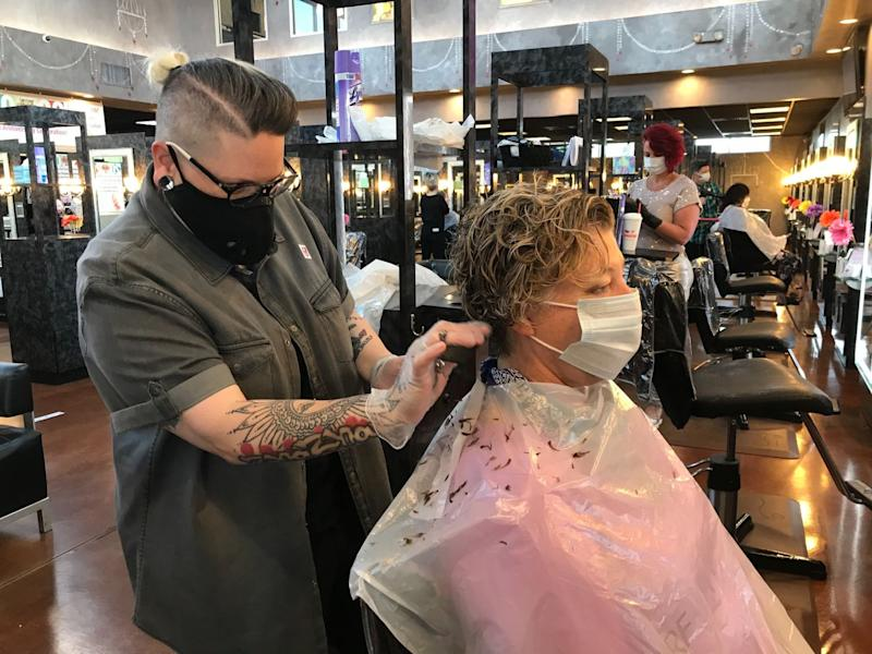 Georgia allows barber shops and gyms to reopen, offering a preview of life after lockdown.