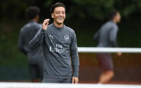 Unai Emery denies training ground spat with Mesut Ozil who was left out of Arsenal squad for West Ham win