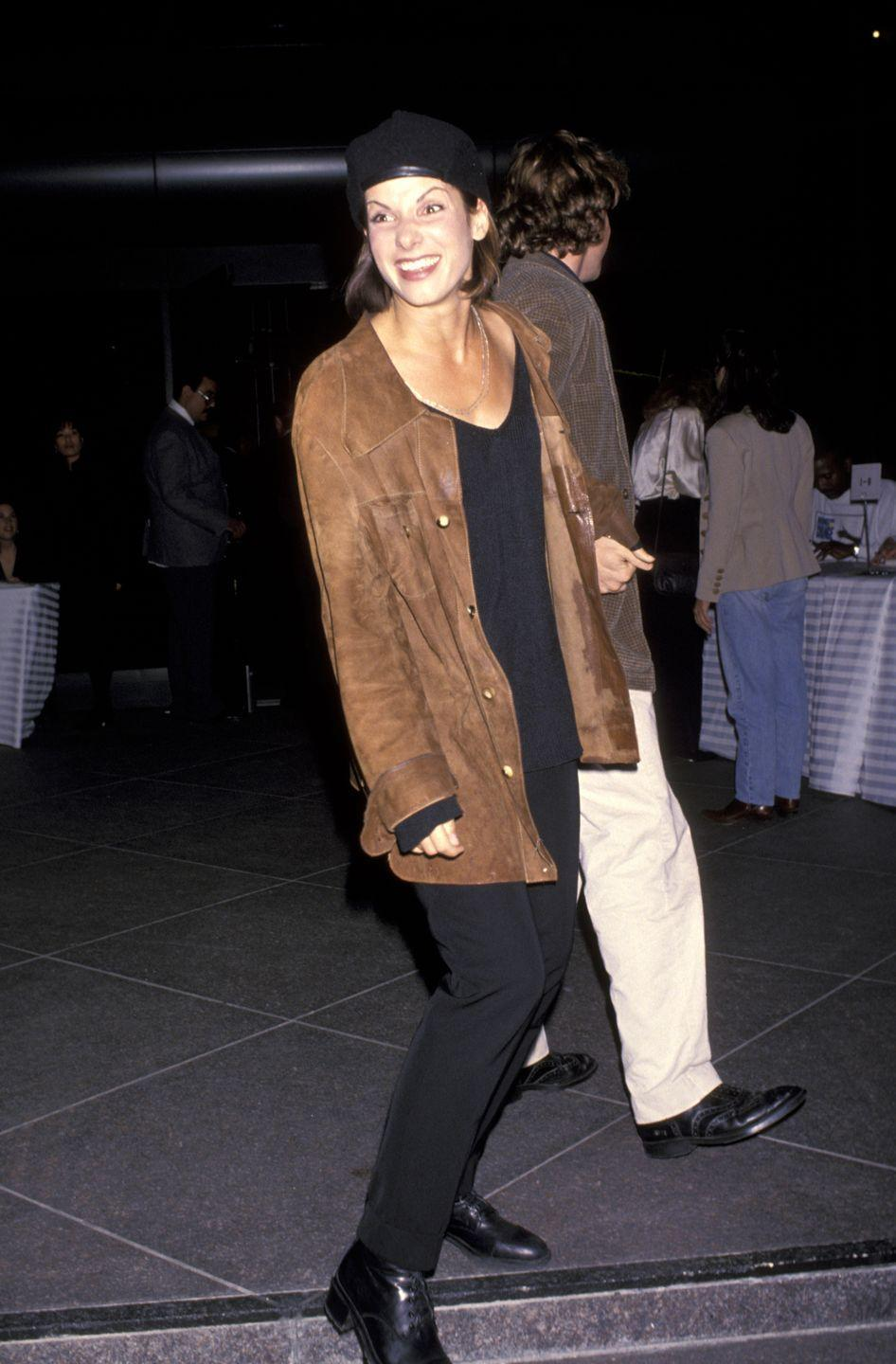 <p>Apparently, brown suede jackets and black berets were officially A Thing in the '80s and '90s. Sandra Bullock, on the heels of her <em>Speed</em> breakout, is a testament to the trend's prominence.</p>