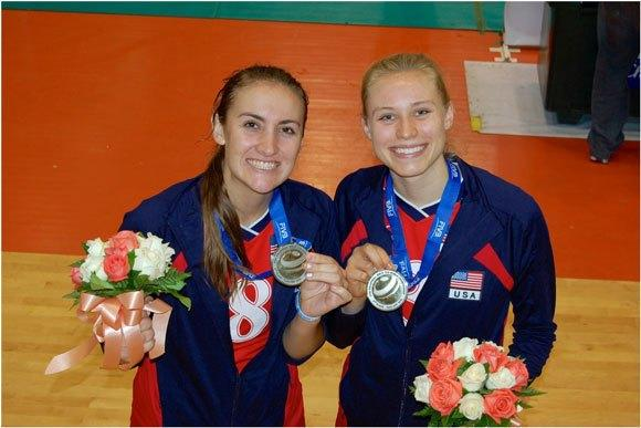 Hayley Hodson, right, and Tia Scambray show off the silver medals they won.