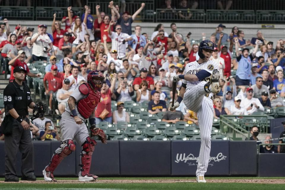 Milwaukee Brewers' Christian Yelich reacts after lining out with bases loaded during the eighth inning of a baseball game against the St. Louis Cardinals Sunday, Sept. 5, 2021, in Milwaukee. (AP Photo/Morry Gash)