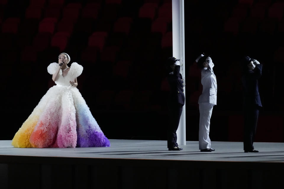 <p>Misia performs during the Japan flag raising during the opening ceremony in the Olympic Stadium. (AP Photo/Ashley Landis)</p>