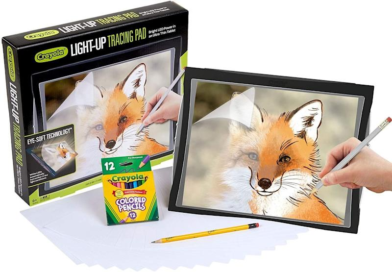 """If the little one in your life loves to draw, you could get them <a href=""""https://amzn.to/3mNYL6T"""" target=""""_blank"""" rel=""""noopener noreferrer"""">this light-up tracing pad</a> from Crayola. It comes with20 tracing paper sheets and 12 short colored pencils. The tracing pad automatically adjusts when there's too much low light, reducing the glare that you would get.<a href=""""https://amzn.to/3mNYL6T"""" target=""""_blank"""" rel=""""noopener noreferrer"""">Find it for $35 at Amazon</a>."""