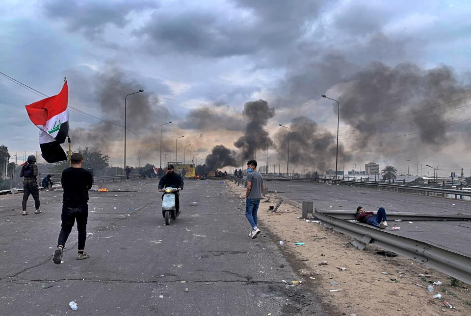 Protesters set fires to close a key highway during clashes with security forces in Baghdad, Iraq, Tuesday, Jan. 21, 2020. (AP Photo/Ali Abdul Hassan)
