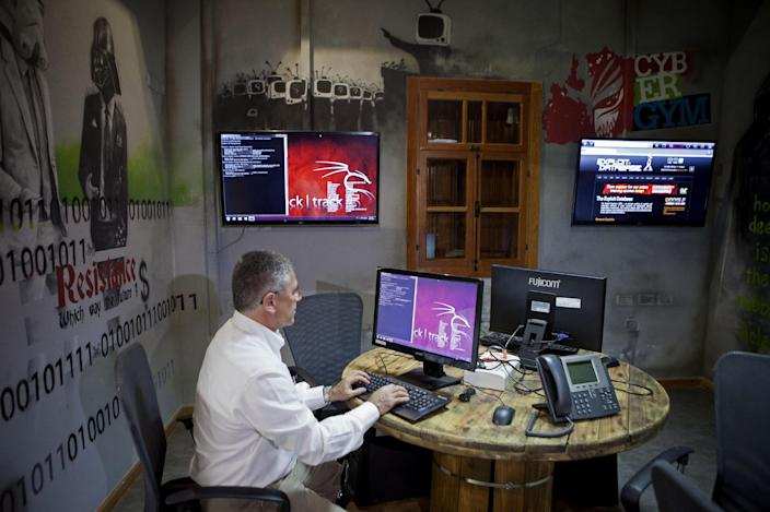 In this Tuesday Oct. 20, 2013 photo, Israel's electric corp vice president, Yasha Hain, works on a computer at the 'CyberGym' school in the coastal city of Hadera. When Israel's military chief delivered a high-profile speech this month outlining the greatest threats his country will face in the future, he listed computer sabotage as a top concern, warning a sophisticated cyber attack could one day bring the nation to a standstill. (AP Photo/Dan Balilty)