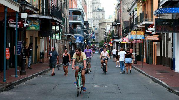 PHOTO: Pedestrians are seen walking along Bourbon Street in the French Quarter on July 14, 2020, in New Orleans. (Sean Gardner/Getty Images, FILE)