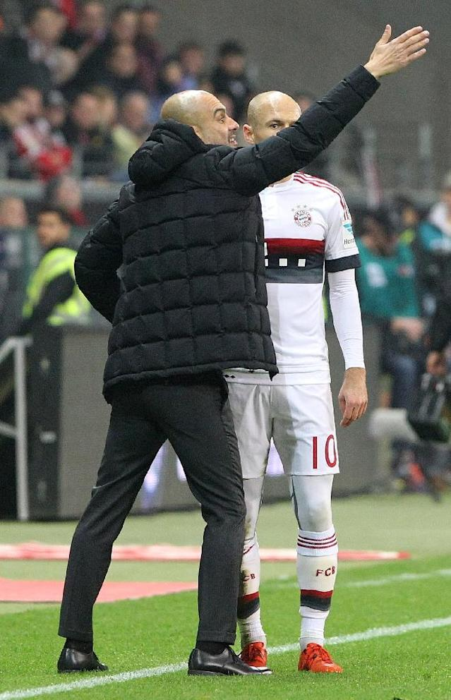 Bayern Munich's Pep Guardiola (L) with Arjen Robben during a Bundesliga match in October (AFP Photo/Daniel Roland)