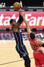 Orlando Magic guard Terrence Ross, left, shoots over Chicago Bulls forward Garrett Temple during the first half of an NBA basketball game in Chicago, Wednesday, April 14, 2021. (AP Photo/Nam Y. Huh)