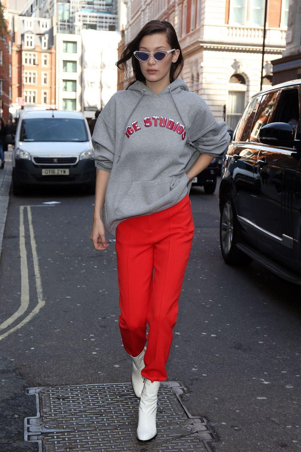 <p>In a Renell Medrano Ice Studios sweatshirt, red pants, Dear Frances white booties and Le Specs x Adam Selman cat-eyed sunglasses while out in London.</p>