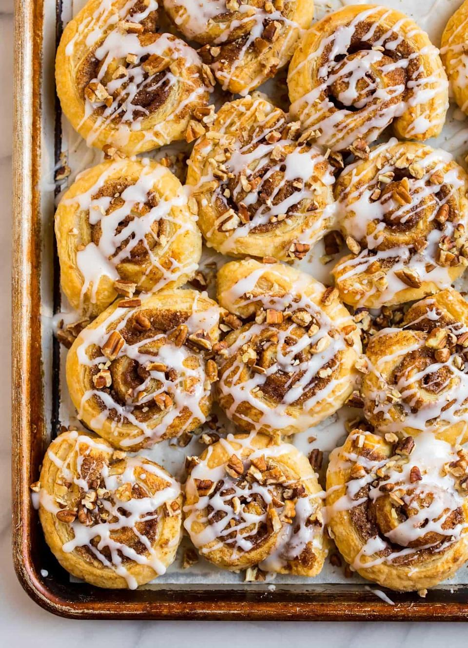 "<p>Back on the cinnamon roll wagon, the people of Oregon know these tasty treats won't disappoint. This recipes calls for pecans, and a powdered sugar, vanilla, and milk glaze. </p> <p><strong>Get the recipe</strong>: <a href=""https://www.wellplated.com/puff-pastry-cinnamon-rolls/"" class=""link rapid-noclick-resp"" rel=""nofollow noopener"" target=""_blank"" data-ylk=""slk:puff pastry cinnamon rolls"">puff pastry cinnamon rolls</a></p>"