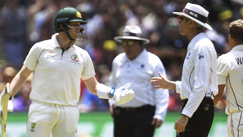 Australia's Steve Smith speaks with umpire Nigel Llong on the first day of the second cricket Test match against New Zealand at the MCG in Melbourne on December 26, 2019.  (Photo by WILLIAM WEST/AFP via Getty Images)
