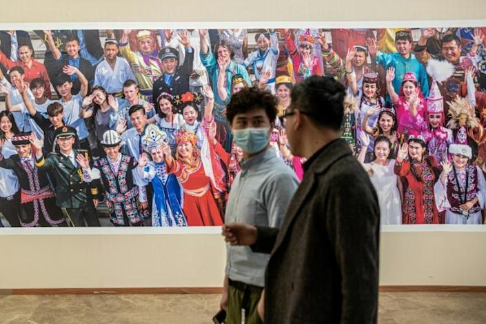 """China is on an elaborate PR offensive to rebrand the northwestern region of Xinjiang where US says """"genocide"""" has been inflicted on the Uyghurs and other Muslim minorities. Photo exhibition on Xinjiang by China Photographers Association"""