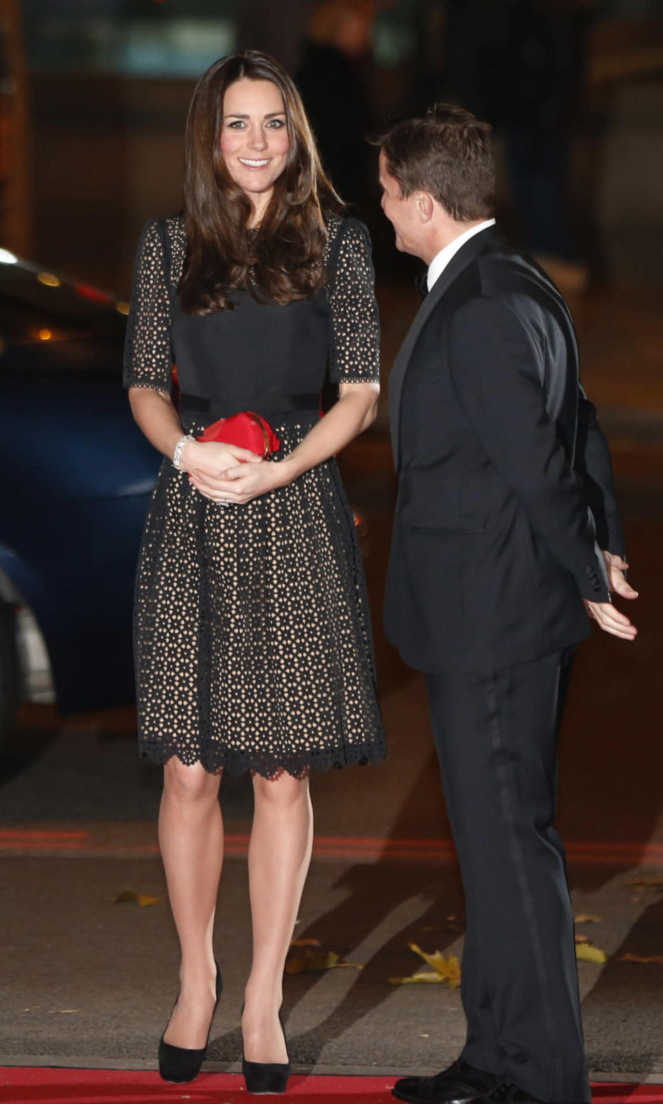 <p>For a sports gala in London, the Duchess chose a shorter black Temperley London dress from the label's AW12 collection. She teamed the look with Jimmy Choo pumps and a red Alexander McQueen bow clutch.</p><p><i>[Photo: PA]</i></p>