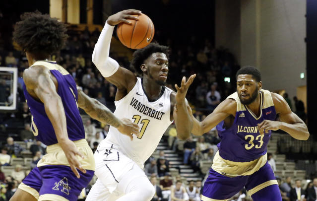 Vanderbilt forward Simisola Shittu (11) drives between Alcorn State's Troymain Crosby, left, and Devon Brewer (33) in the first half of an NCAA college basketball game Friday, Nov. 16, 2018, in Nashville, Tenn. (AP Photo/Mark Humphrey)