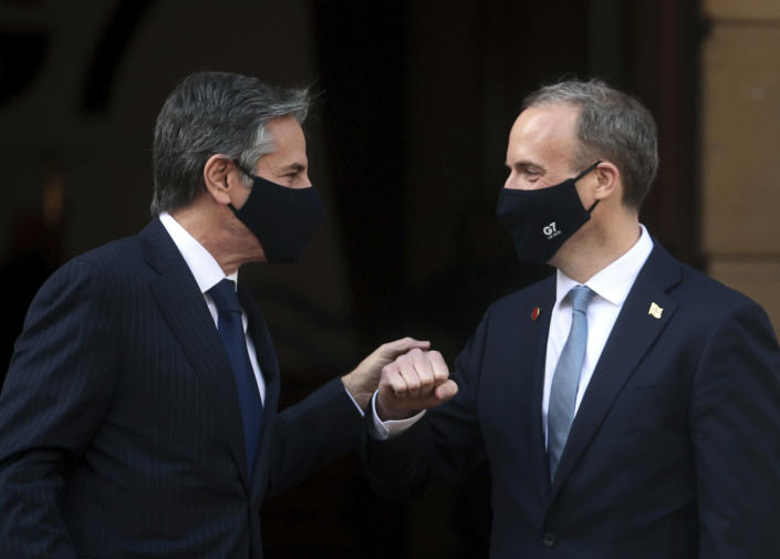 Britain's Foreign Secretary Dominic Raab, right, poses for a photo with US Secretary of State, Antony Blinken, prior to talks, during the G7 foreign ministers' meeting, at Lancaster House in London, Wednesday, May 5, 2021. Diplomats from the group of wealthy nations are meeting in London for their first face-to-face gathering in two years. (Hannah McKay/Pool Photo via AP)