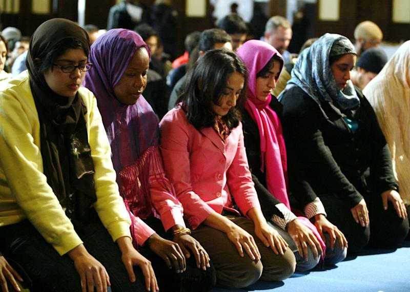 A group of women pray at the end of a public mixed-gender Muslim prayer service that was held in New York City, March 18, 2005.