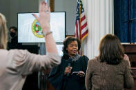 FILE - In this Dec. 14, 2020, file photo Chief Justice of the North Carolina Supreme Court Cheri Beasley, center, swears in Presidential electors of North Carolina's Electoral College as they gather to cast their votes at the State Capitol Building in Raleigh, N.C. In addition to Virginia, two Black women are running for U.S. Senate from North Carolina in 2022: former state Supreme Court Chief Justice Cheri Beasley and former legislator Erica Smith. (AP Photo/Gerry Broome, File)