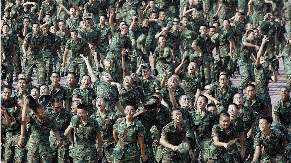 Recruits throw their cap in the air at the passing-out-parade