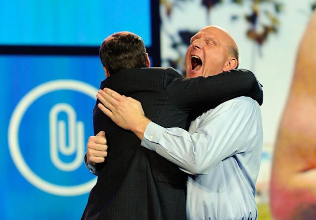 LAS VEGAS, NV - JANUARY 09: Microsoft CEO Steve Ballmer hugs host Ryan Seacrest before his keynote address at the 2012 International Consumer Electronics Show at the Las Vegas Convention Center January 9, 2012 in Las Vegas, Nevada. CES, the world's largest annual consumer technology trade show, runs through January 13 and is expected to feature 2,700 exhibitors showing off their latest products and services to about 140,000 attendees. (Photo by Kevork Djansezian/Getty Images)