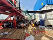 """Migrants sit onboard """"Ocean Viking"""" ship as they wait to disembark, in Augusta"""