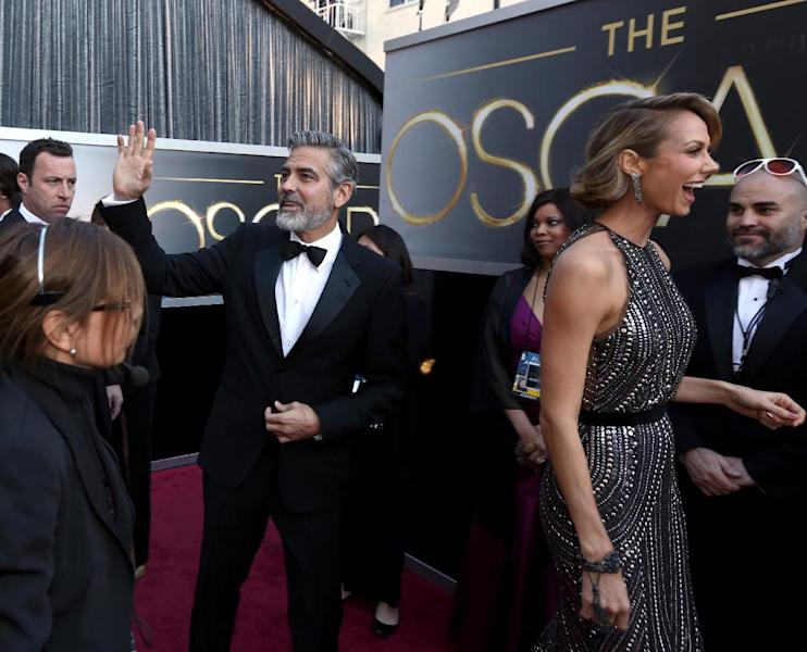Actors George Clooney, left, and Stacy Keibler arrive at the Oscars at the Dolby Theatre on Sunday Feb. 24, 2013, in Los Angeles. (Photo by Matt Sayles/Invision/AP)