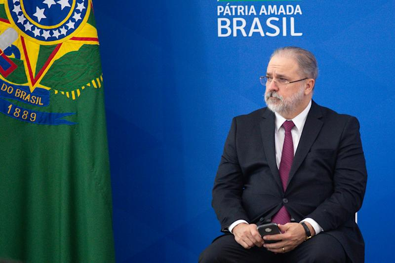 BRASILIA, BRAZIL - APRIL 17: Brazilian Attorney General Augusto Aras reacts during the sworn-in of newly appointed Health Minister Nelson Teich amidst coronavirus (COVID-19) pandemic at the Planalto Palace on April, 17, 2020 in Brasilia. President Bolsonaro has fired outgoing Minister of Health Luiz Henrique Mandetta on Thursday 16th over differences in coronavirus strategy. Brazil has over 30,000 confirmed positive cases of Coronavirus and 1956 deaths. (Photo by Andressa Anholete/Getty Images)
