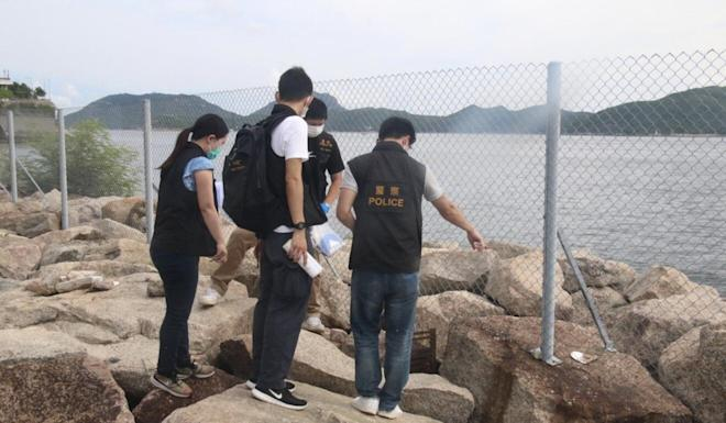 A team of Hong Kong police officers visited Cyberport Waterfront Park on Monday while investigating a string of dog poisonings in the area. Photo: Handout
