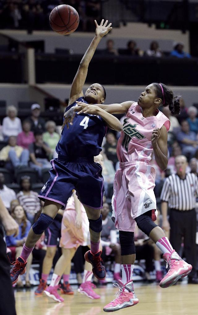 Connecticut guard Moriah Jefferson (4) gets fouled by South Florida guard Courtney Williams (10) during the first half of an NCAA women's college basketball game, Sunday, Feb. 16, 2014, in Tampa, Fla. (AP Photo/Chris O'Meara)
