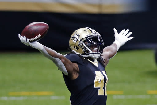 New Orleans Saints running back Alvin Kamara (41) celebrates his touchdown in the first half of an NFL football game against the Tampa Bay Buccaneers in New Orleans, Sunday, Sept. 13, 2020. (AP Photo/Brett Duke)
