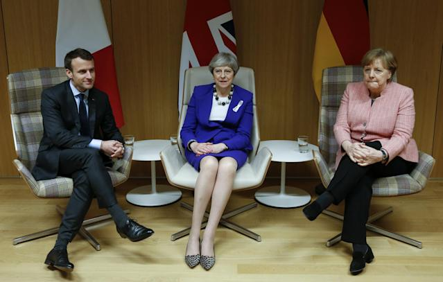 Britain's Prime Minister Theresa May is flanked by French President Emmanuel Macron and German Chancellor Angela Merkel before their trilateral meeting at the European Union leaders summit in Brussels, Belgium, March 22, 2018. REUTERS/Francois Lenoir TPX IMAGES OF THE DAY