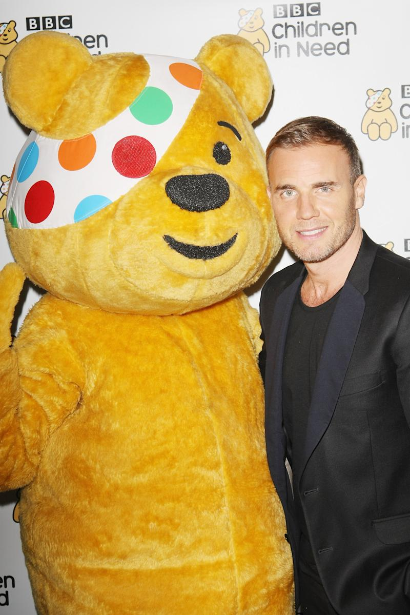 LONDON, ENGLAND - OCTOBER 30: (EXCLUSIVE COVERAGE) Gary Barlow posing with Pudsey at BBC Radio 2 Weekend Wogan In Aid Of BBC Children In Need at The Savoy Theatre on October 30, 2011 in London, England. (Photo by Jon Furniss/WireImage)