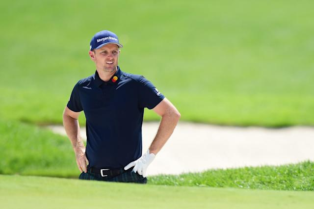 """<h1 class=""""title"""">The Northern Trust - Round Two</h1> <div class=""""caption""""> Justin Rose assesses his lie during the second round of The Northern Trust at Liberty National Golf Club. </div> <cite class=""""credit"""">(Photo by Jared C. Tilton/Getty Images)</cite>"""