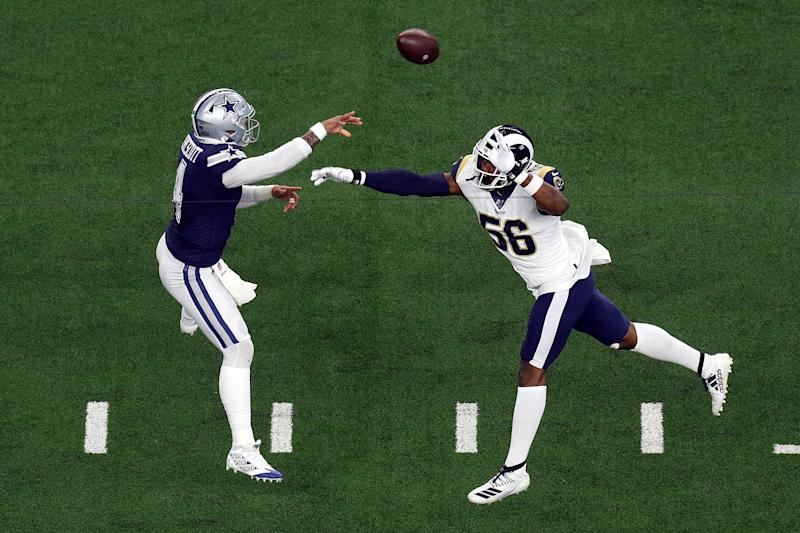 ARLINGTON, TEXAS - DECEMBER 15: Dak Prescott #4 of the Dallas Cowboys passes under pressure from Dante Fowler #56 of the Los Angeles Rams in the first quarter at AT&T Stadium on December 15, 2019 in Arlington, Texas. (Photo by Richard Rodriguez/Getty Images)