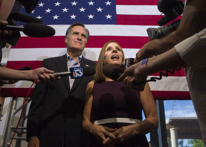 McSally, accompanied by former Republican presidential nominee Mitt Romney, answers questions during a rally on Oct. 12, 2018, in Gilbert, Ariz. (Photo: Darryl Webb/AP)
