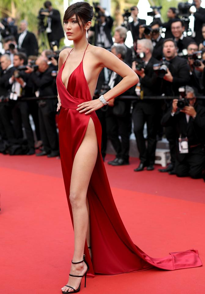<p>The model also showed too much — in the form of her undies — when she walked the red carpet in this shiny red dress, with a waist-high opening — in Cannes last May. Maybe that's what helped her get her Victoria's Secret Fashion Show gig? (Photo: Getty Images) </p>