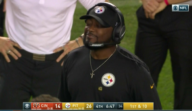 Mike Tomlin winks following his team's execution of a fake punt against the Bengals. (Screen shot via CBS)