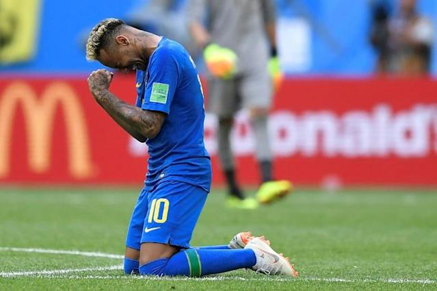 Brazil's forward Neymar reacts after scoring his goal during Brazil's World Cup match against Costa Rica in Saint Petersburg