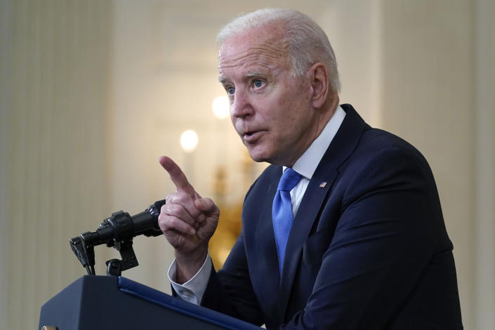President Joe Biden gesturing as he takes questions from reporters as he speaks about the American Rescue Plan, in the State Dining Room of the White House, Wednesday, May 5, 2021, in Washington. (AP Photo/Evan Vucci)