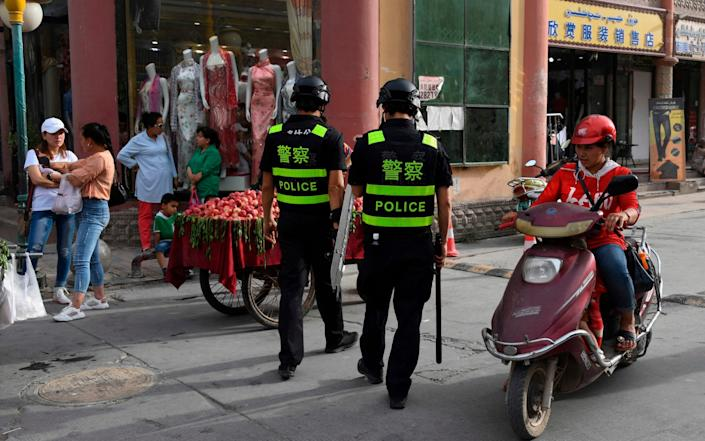 Police patrolling in Kashgar, a city in China's western Xinjiang region. - AFP