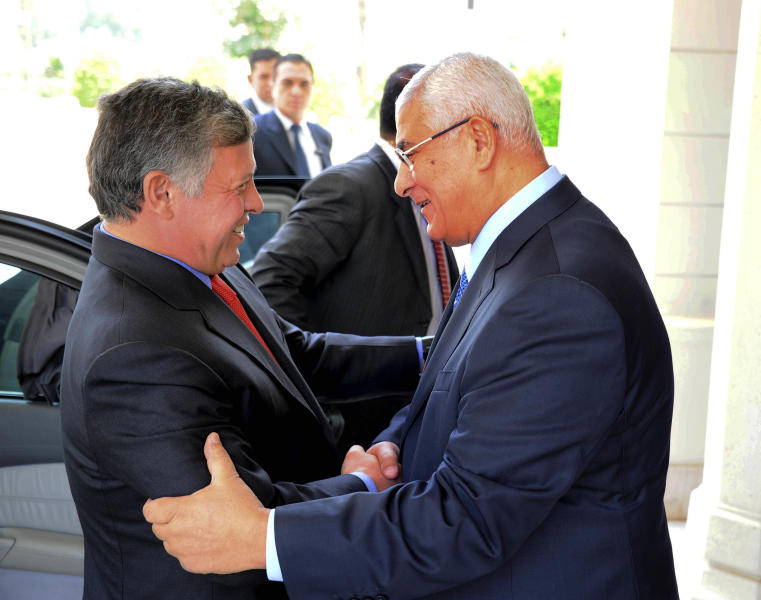 CAPTION CORRECTION, CORRECTS NAME TO KING ABDULLAH II -- In this image released by the Egyptian Presidency, Egyptian President Adly Mansour, right, greets Jordan's King Abdullah II on his arrival to the presidential palace, Saturday, July 20, 2013. Jordan's King arrived in Egypt's capital on Saturday for a short visit -- the first visit by a head of state to Egypt since the ouster of President Mohamed Morsi on July 3, 2013. (AP Photo/Egyptian Presidency)