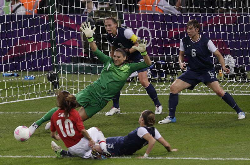 United States goalkeeper Hope Solo (1)makes a save against Japan during the women's soccer gold medal match at the 2012 Summer Olympics, Thursday, Aug. 9, 2012, in London. (AP Photo/Andrew Medichini)
