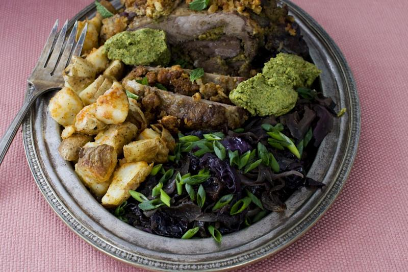 In this image taken on March 11, 2013, orange and mint-stuffed lamb with sweet-and-sour cabbage is shown served on a plate in Concord, N.H. (AP Photo/Matthew Mead)