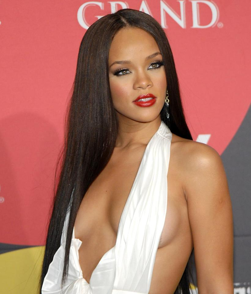 <p>This sleek middle part is everything I've ever wanted and more. Her bone-straight hair allows her bold red lip to pop so beautifully at the 2006  Billboard Music Awards.</p>