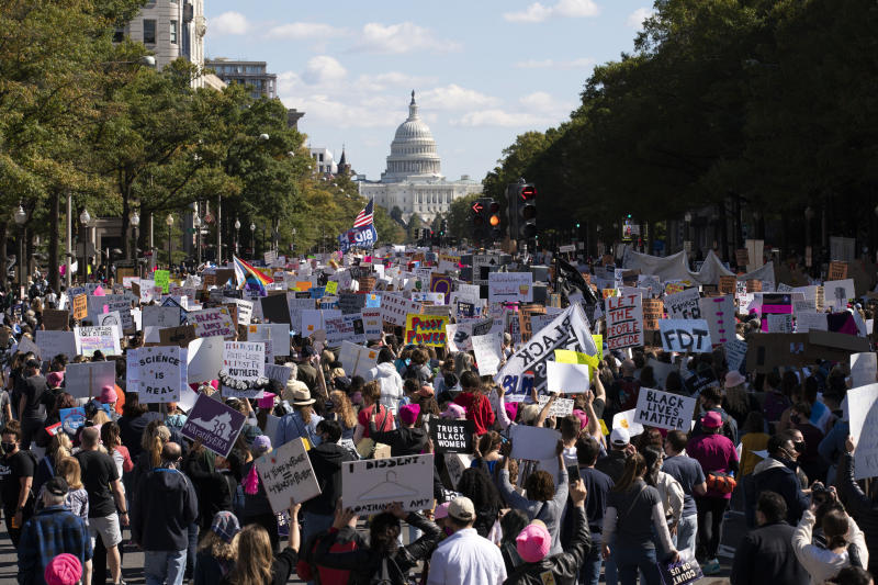 With the US Capitol in the background demonstrators march on Pennsylvania Avenue