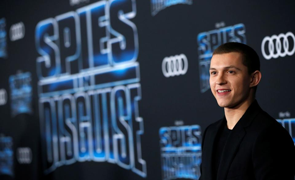 Cast member Tom Holland poses at the premiere for the film
